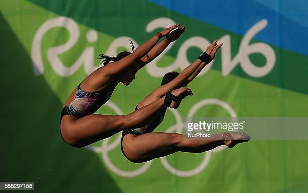 Jun Hoong Cheong and Pandelela Rinong Pamg of Malaysia compete during the women's synchronised 10m platform diving at the 2016 Rio Olympic Games in...