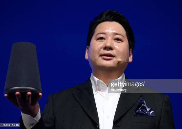 Jun Masuda chief strategy and marketing officer of Line Corp holds the company's Wave smart speaker during the companys annual strategy briefing in...