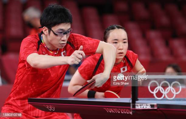 Jun Mizutani and Ito Mima of Team Japan in action during their Mixed Doubles Round of 16 table tennis match on day one of the Tokyo 2020 Olympic...