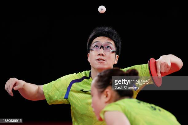 Jun Mizutani and Ito Mima of Team Japan in action during their Mixed Doubles Semifinal match on day two of the Tokyo 2020 Olympic Games at Tokyo...
