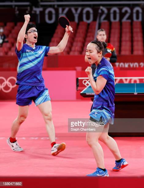 Jun Mizutani and Ito Mima of Team Japan react during their Mixed Doubles Quarterfinal match on day two of the Tokyo 2020 Olympic Games at Tokyo...