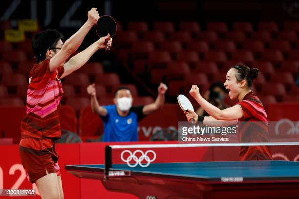 Jun Mizutani and Mima Ito of Japan celebrate after winning the Mixed Doubles Gold Medal Match against Xu Xin and Liu Shiwen of China on day three of...