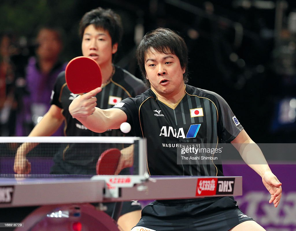 Jun Mizutani (L) and Seiya Kishikawa of Japan compete against Adrian Crisan and Andrei Filimon of Romania in the Men's Doubles 2nd round during day four of the World Table Tennis Championships on May 16, 2013 in Paris, France.