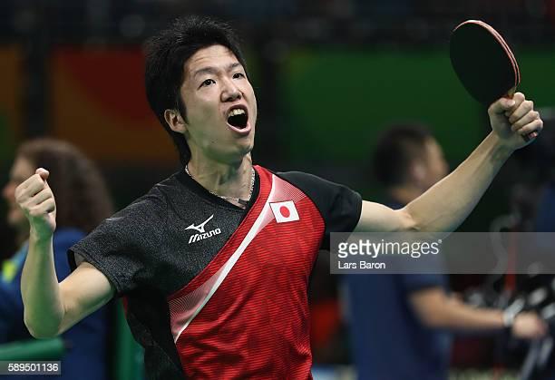 Jun Mizutani celebrates during the Table Tennis Men's Quarterfinal Match between Japan and Hon Kong on August 14, 2016 in Rio de Janeiro, Brazil.