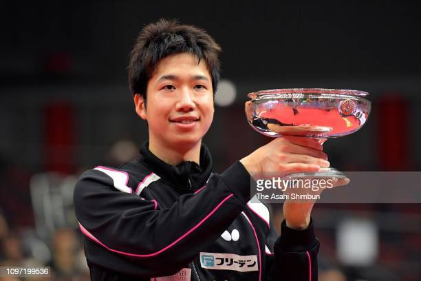 Jun Mizutani celebrates with the trophy during the medal ceremony for the Men's Singles on day seven of the All Japan Table Tennis Championships at...