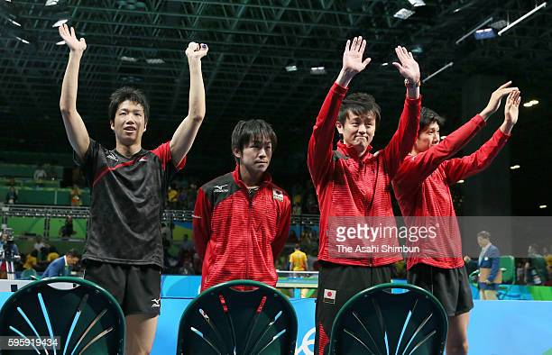 Jun Mizutani Koki Niwa head coach Yosuke Kurashima and Maharu Yoshimura of Japan celebrate their win in the Table Tennis Men's Team Round One Match...