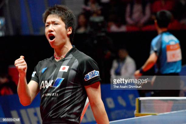 Jun Mizutani of Japan celebrates a point against Lee Sangsu of South Korea in the Men's quarter final on day six of the World Team Table Tennis...