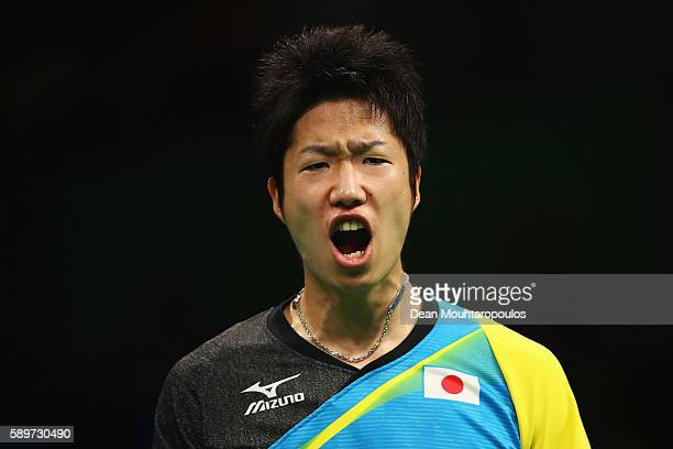Jun Mizutani of Japan celebrates a point against Timo Boll of Germany during Mens Team Semifinal on Day 10 of the Rio 2016 Olympic Games at Riocentro...