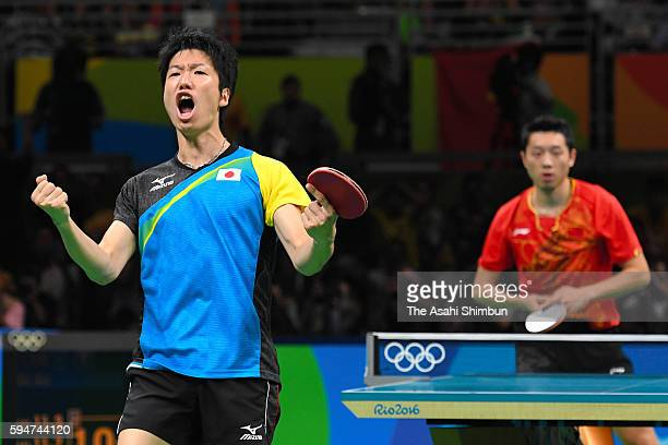 Jun Mizutani of Japan celebrates a point against Xu Xin of China during the the Men's Team Table Tennis gold medal match on Day 12 of the Rio 2016...