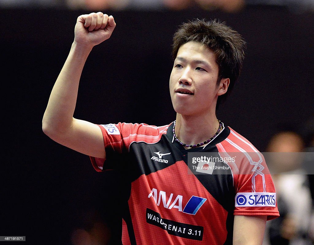 Jun Mizutani of Japan celebrates a point during the match against Panagiotis Gionis of Greece during day one of the 2014 World Team Table Tennis Championships at Yoyogi National Gymnasium on April 28, 2014 in Tokyo, Japan.
