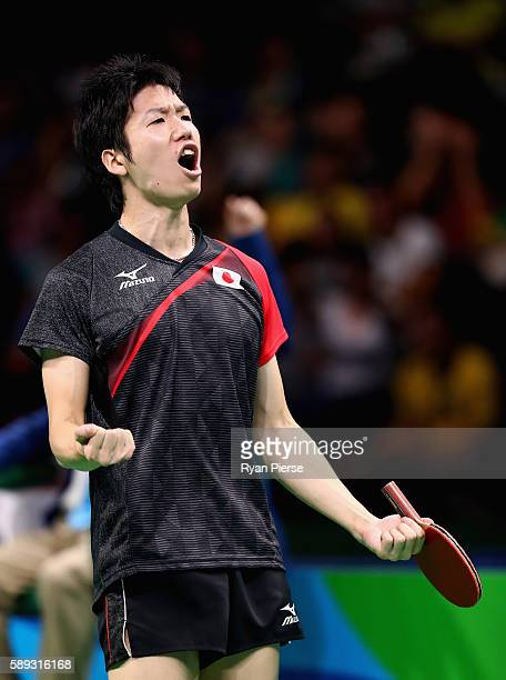 Jun Mizutani of Japan celebrates after winning match point during the Table Tennis Men's Team Round One Match between Japan and Poland during Day 8...