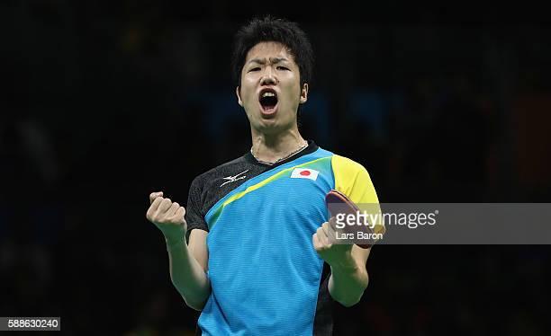 Jun Mizutani of Japan celebrates during the Mens Table Tennis Bronze Medal match between Jun Mizutani and Vladimir Samsonov of Belarus at Rio Centro...