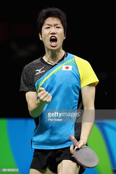 Jun Mizutani of Japan celebrates during the Men's Table Tennis gold medal match against Xin Xu of China at Riocentro - Pavilion 3 on Day 12 of the...