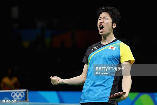 Jun Mizutani of Japan celebrates during the Men's Table Tennis gold medal match against Xin Xu of Japan at Riocentro Pavilion 3 on Day 12 of the Rio...
