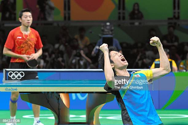Jun Mizutani of Japan celebrates his win against Xu Xin of China during the the Men's Team Table Tennis gold medal match on Day 12 of the Rio 2016...