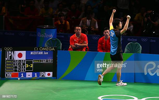 Jun Mizutani of Japan celebrates in a match against Xu Xin of China during the Men's Table Tennis gold medal match on Day 12 of the Rio 2016 Olympic...