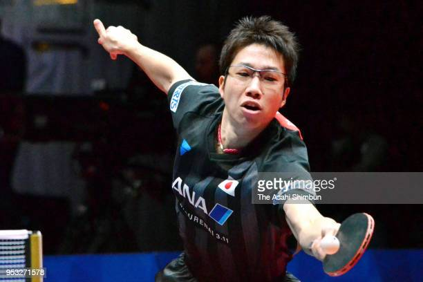 Jun Mizutani of Japan competes against Aliaksandr Khanin of Beralus in the Men's Group C match between Japan and Beralus on day two of the World Team...