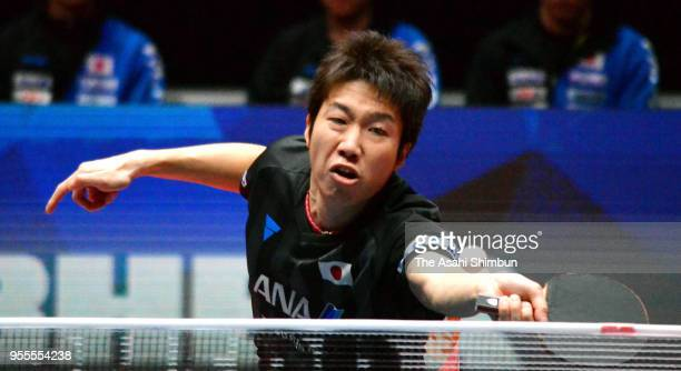 Jun Mizutani of Japan competes against Lee Sangsu of South Korea in the Men's quarter final on day six of the World Team Table Tennis Championships...
