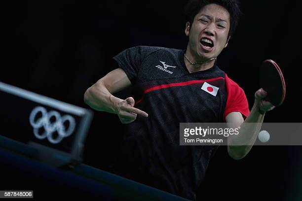 Jun Mizutani of Japan competes against Marcos Freitas of Portugal during the Men's Singles Quarterfinal 2 Table Tennis on Day 4 of the Rio 2016...