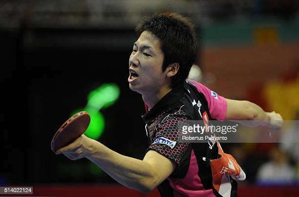 Jun Mizutani of Japan competes against Xu Xin of China during the 2016 World Table Tennis Championship Men's Team Division final match at Malawati...