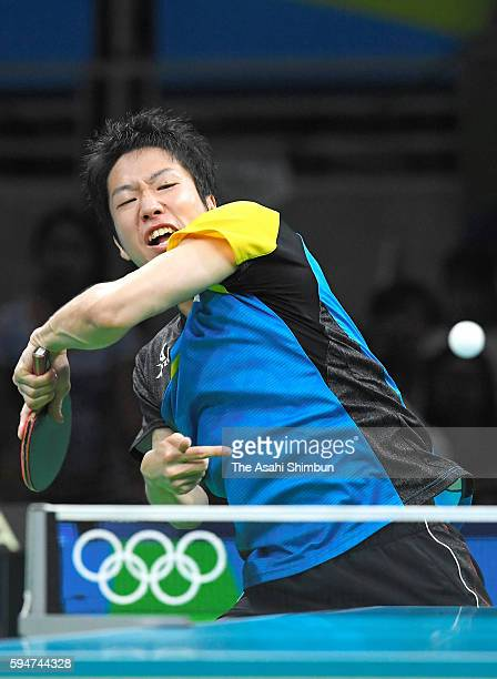 Jun Mizutani of Japan competes against Xu Xin of China during the the Men's Team Table Tennis gold medal match on Day 12 of the Rio 2016 Olympic...