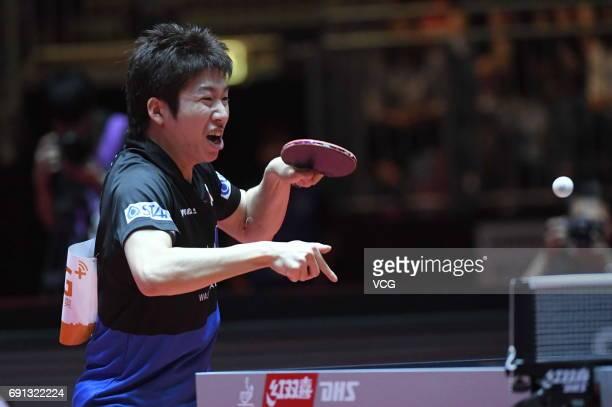 Jun Mizutani of Japan competes during Men's Singles second round match against Tomokazu Harimoto of Japan on day 4 of World Table Tennis...