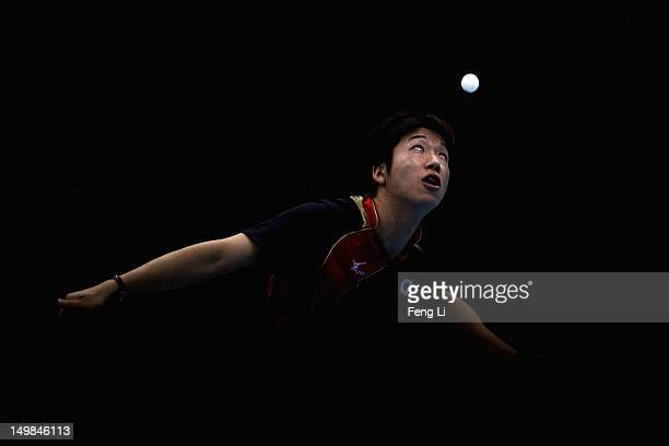 Jun Mizutani of Japan competes during Men's Team Table Tennis quarterfinal match against team of Hong Kong, China on Day 9 of the London 2012 Olympic...
