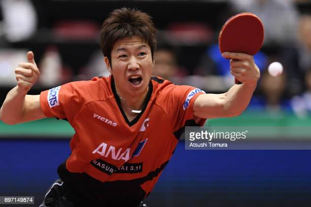 Jun Mizutani of Japan competes during the men's singles semi final match against Zhendong Fan of China on the day 5 of the 2017 ITTF World Tour...