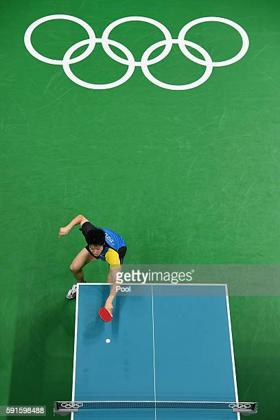 Jun Mizutani of Japan competes during the Men's Table Tennis gold medal match against Long Ma of China at Riocentro Pavilion 3 on Day 12 of the Rio...