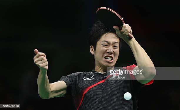 Jun Mizutani of Japan competes during the Mens Table Tennis Singles Semifinal match between Ma Long of China and Jun Mizutani of Japan at Rio Centro...