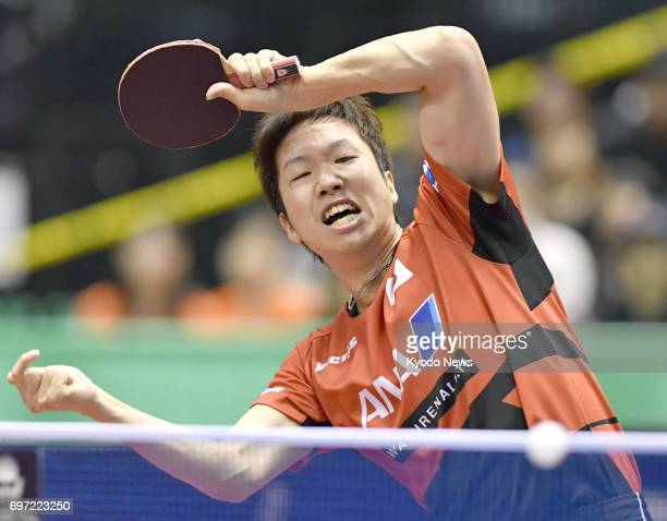 Jun Mizutani of Japan hits a forehand during his semifinal match against Fan Zhendong of China at the Japan Open table tennis tournament at Tokyo...