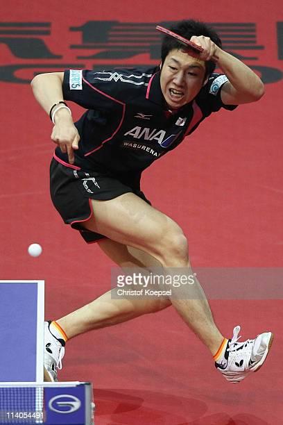 Jun Mizutani of Japan plays a forehand during the second round Men's Single match between Jun Mizutani of Japan and Liu Song of Argentina during the...