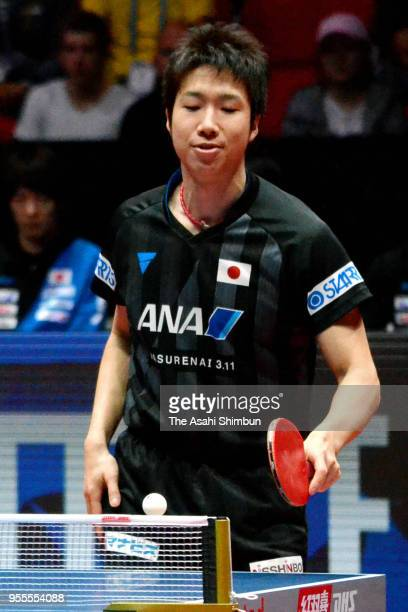 Jun Mizutani of Japan reacts after losing a point against Jeoung Youngsik of South Korea in the Men's quarter final on day six of the World Team...