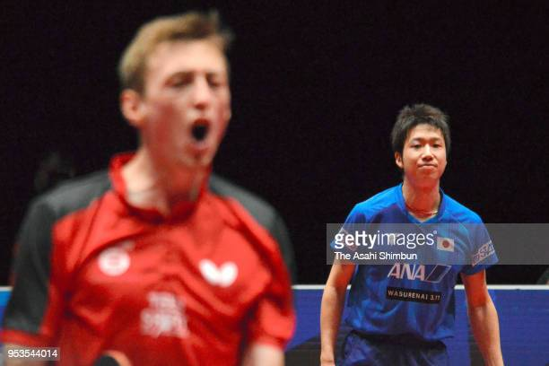 Jun Mizutani of Japan reacts after losing a point against Liam Pitchford of England in the Men's Group C match between Japan and England on day two...