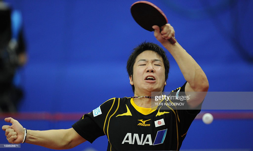 Jun Mizutani of Japan returns a service to Cristian Kongsgaard of Denmark during their men's teams group C match at the 2010 World Team Table Tennis Championships in Moscow on May 25, 2010.