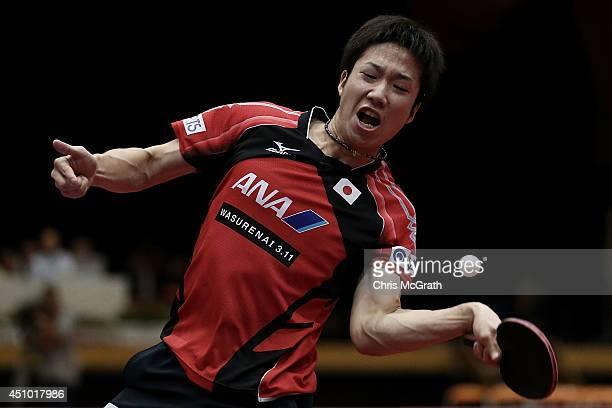 Jun Mizutani of Japan returns a shot against Yuto Muramatsu of Japan during their Men's Singles Semi final match on day three of 2014 ITTF World Tour...