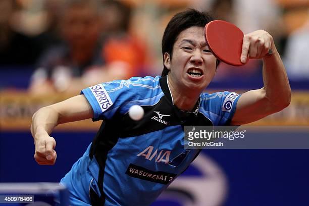 Jun Mizutani of Japan returns a shot against Zhan Jian of Singapore during their Men's Singles Quarter final match on day two of 2014 ITTF World Tour...