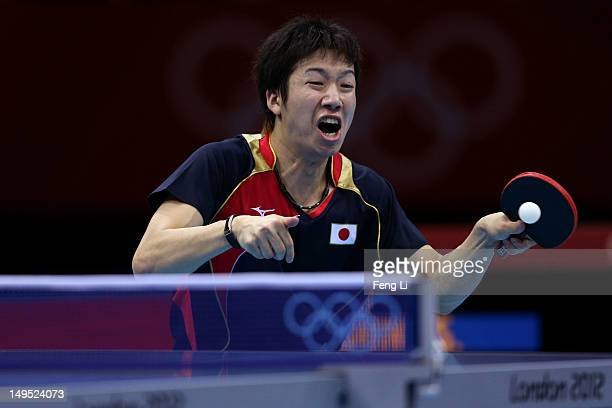 Jun Mizutani of Japan returns the ball during his Men's Singles Table Tennis third round match against Elsayed Lashin of Egypt on Day 3 of the London...