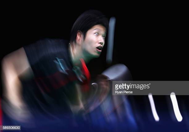 Jun Mizutani of Japan serves during the Table Tennis Men's Team Round One Match between Japan and Poland during Day 8 of the Rio 2016 Olympic Games...