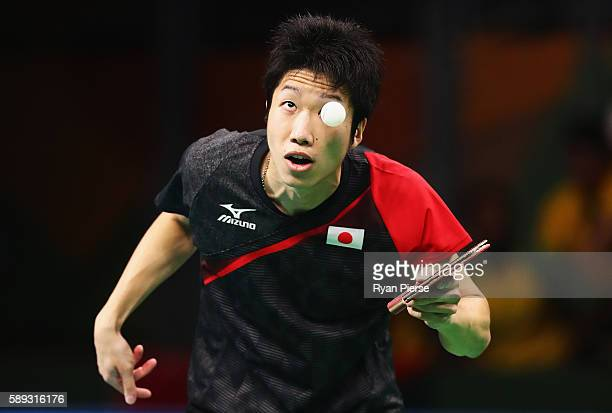 Jun Mizutani of Japan serves point during the Table Tennis Men's Team Round One Match between Japan and Poland during Day 8 of the Rio 2016 Olympic...
