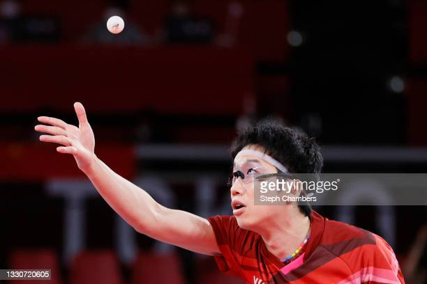 Jun Mizutani of Team Japan in action during his Mixed Doubles Gold Medal match on day three of the Tokyo 2020 Olympic Games at Tokyo Metropolitan...