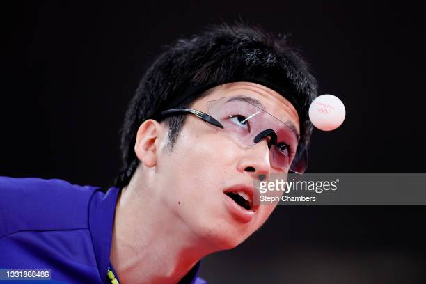 Jun Mizutani of Team Japan serves during his Men's Team Round of 16 table tennis match on day ten of the Tokyo 2020 Olympic Games at Tokyo...