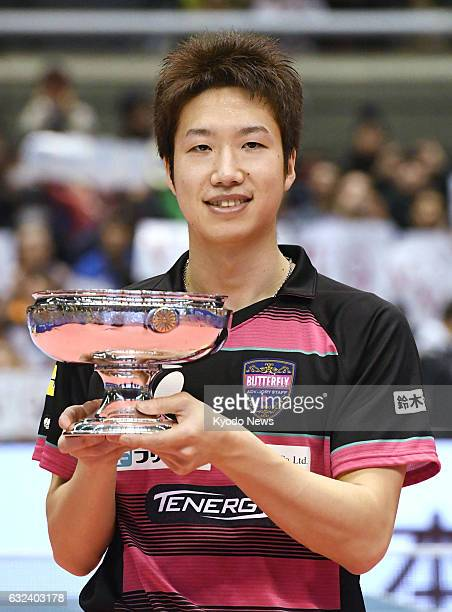Jun Mizutani poses with the Emperor's Cup after winning the men's singles final at the national table tennis championships at Tokyo Metropolitan...