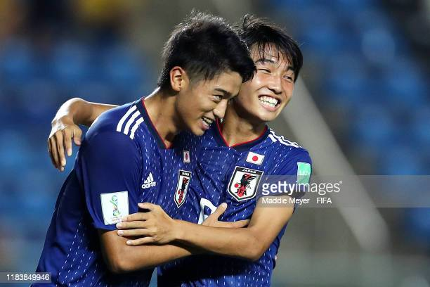 Jun Nishikawa of Japan left celebrates with Hikaru Naruoka after scoring a penalty kick during the Group D Match between Japan and Netherlands in the...