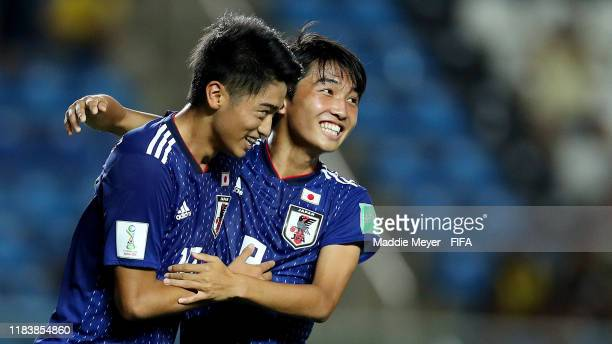 Jun Nishikawa of Japan, left, celebrates with Hikaru Naruoka after scoring a penalty kick during the Group D Match between Japan and Netherlands in...