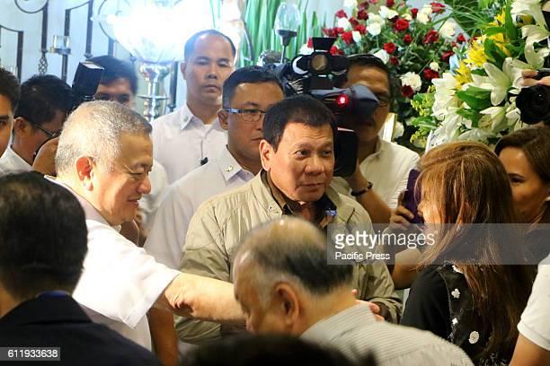 Jun Santiago assisted President Rodrigo Duterte while talking Ilocos Norte Governor Maria Imelda Josefa Imee Romualdez Marcos during the wake of Sen...