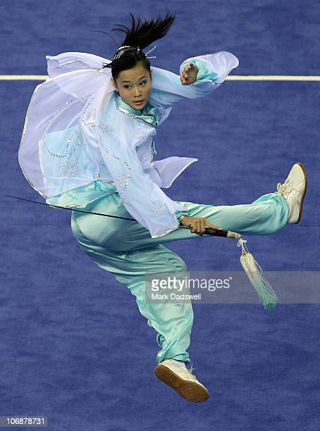 Jun Tao Yi of Singapore competes in the Women's Taijijian section of the Wushu competition at Nansha Gymnasium during day three of the 16th Asian...