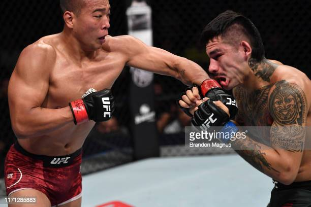 Jun Yong Park of China punches Anthony Hernandez in their middleweight bout during the UFC Fight Night event at Shenzhen Universiade Sports Centre on...