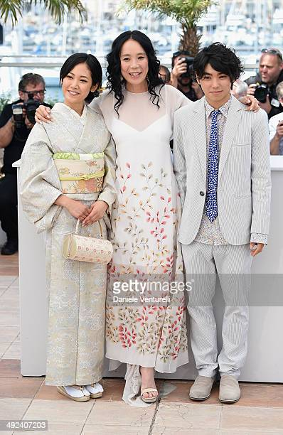 Jun Yoshinaga Naomi Kawase and Nijiro Murakami attends the 'Still The Water' Photocall during the 67th Annual Cannes Film Festival on May 20 2014 in...