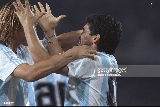 Claudio Cannigia and Diego Maradona both of Argentina celebrate during a match at the World Cup in Italy Mandatory Credit Billy Stickland/Allsport